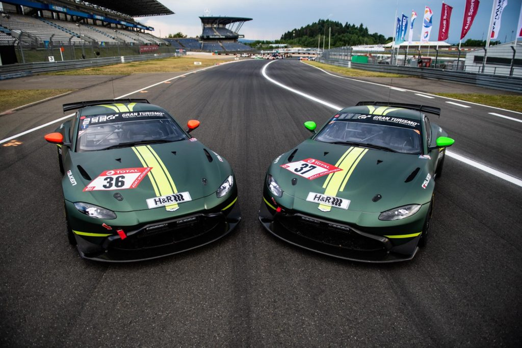 Two of the Aston Martins