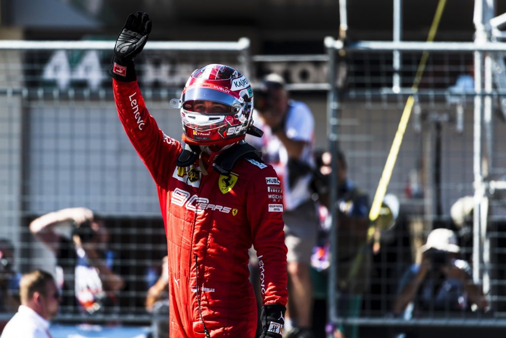 Charles Leclerc waving to the crowd
