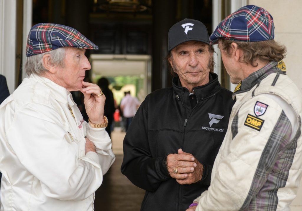 Jackie Stewart chatting with Emerson Fittipaldi