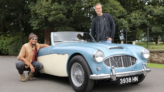 Tim and Fuzz pose beside the restored Austin Healey 3000